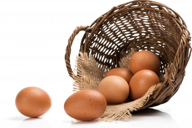 Eggs spilling out of a basket