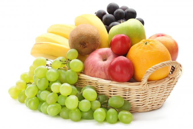 Assorted fruit piled in a basket